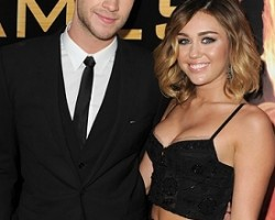 Liam Hemsworth and Miley Cyrus - Getty