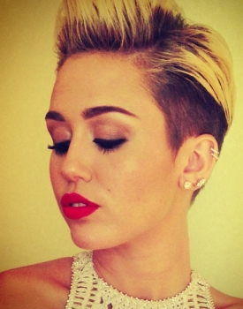 miley denies behind tattoo